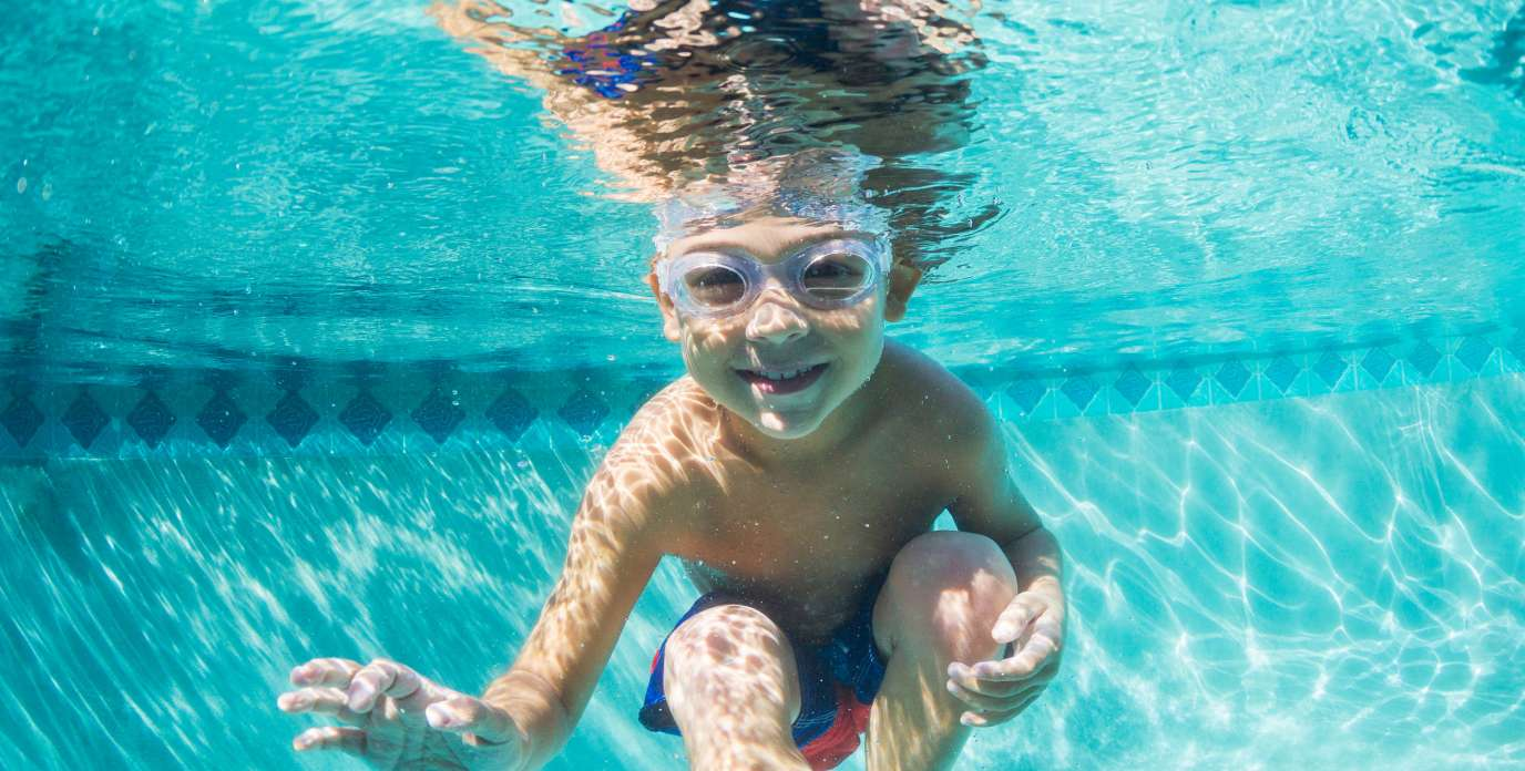 Young Boy Diving Underwater